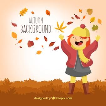 Dziewczynka zabawy podczas jesieni