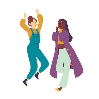 Dziewczyny cieszą się na przyjęciu młoda piękna kobieta tańczy.