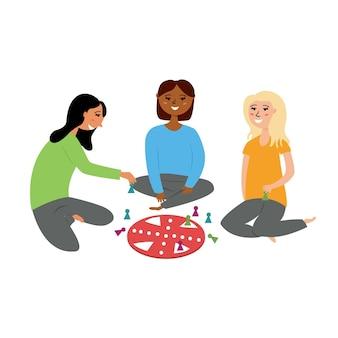Dziewczyny grają w grę planszową