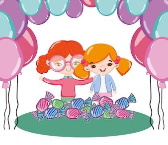 Dziewczyny przyjaciele z balonami i słodkimi cukierkami