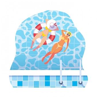 Dziewczyny w strojach kąpielowych i ratownik pływają w wodzie