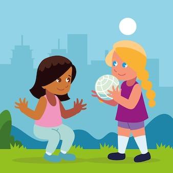 Dziewczyny z piłką grające w parku