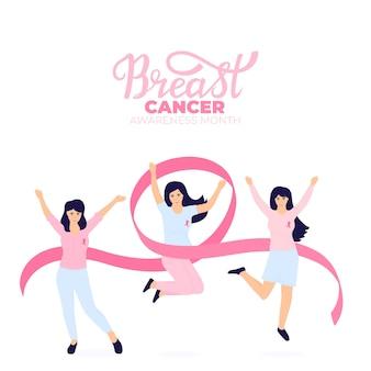 Dziewczyny z różowymi wstążkami skaczą i bawią się. narodowy miesiąc świadomości raka piersi.