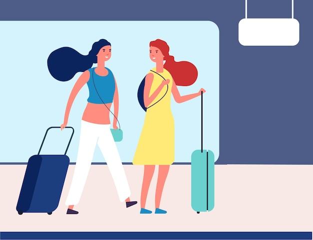 Dziewczyny z walizkami. młodzi podróżnicy na lotnisku lub dworcu autobusowym.