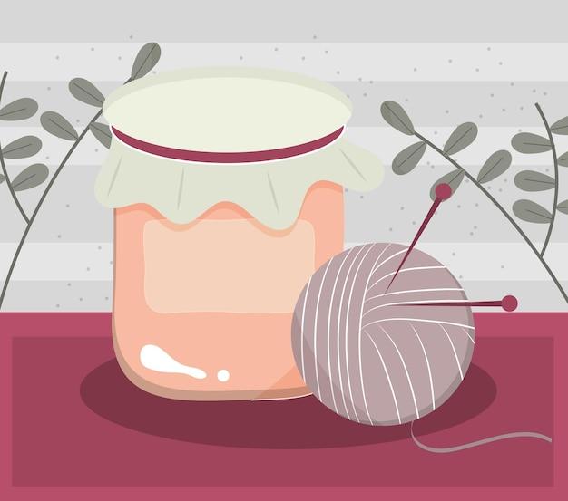 Dziewiarska wełna, igły i dżem ze słoika