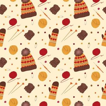 Dziewiarskie wzór czapki i rękawiczki. ręcznie robiona odzież z dzianiny. kulki z włóczki, igły, szydełko, tradycyjne jesienne narzędzia hobbystyczne, akcesoria.