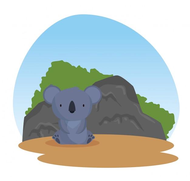Dzikie zwierzę koala z krzakami i kamieniami