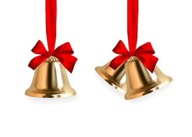 Dzwonek dzwoni. zimowy złoty dzwonek z czerwoną kokardką. element dekoracji świątecznej.