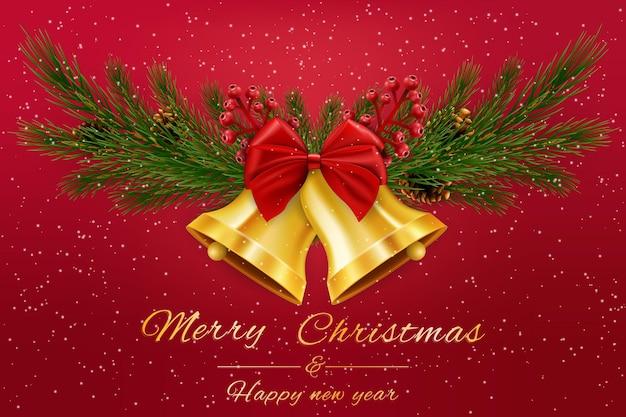 Dzwonki bożonarodzeniowe z czerwoną wstążką i gałązkami jodły