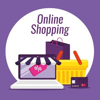 E-commerce na laptopa z kartą kredytową i koszem