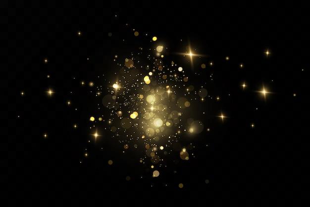 Efekt brokatu drobinek. złoto lśni. na przezroczystym tle błyszczące cząsteczki pyłu gwiazdowego. illustration.magic.christmas.cosmic dust.