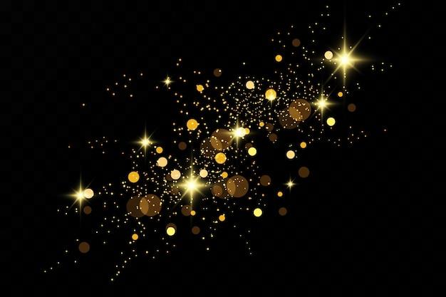 Efekt brokatu drobinek. złoto lśni. na przezroczystym tle błyszczące cząsteczki pyłu gwiazdowego.