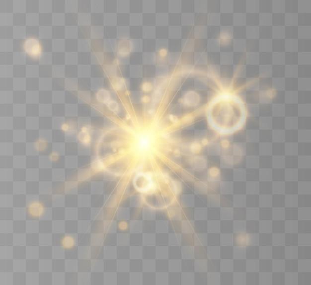 Efekt świetlny błysk miga z wiązkami i reflektorem żółte świecące światło piękna gwiazda światło z