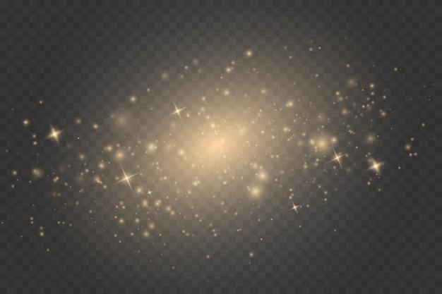 Efekt świetlny gold glow. iskry i gwiazdy błyszczą specjalnym efektem świetlnym