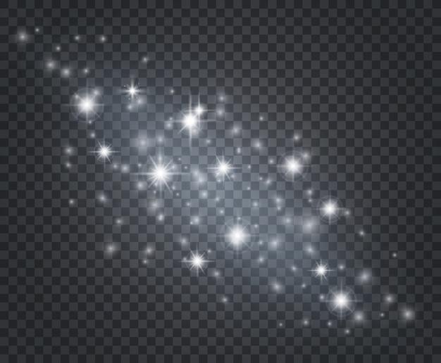 Efekt świetlny. świecący gwiezdny pył, słońce migocze promieniami. na białym tle starburst z błyszczy. boże narodzenie tło dekoracji.
