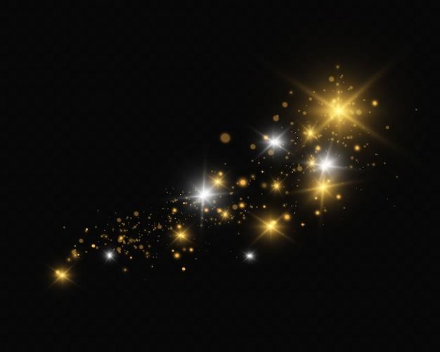 Efekty świetlne. błyszczy na przezroczystym tle. świąteczny efekt świetlny. lśniące magiczne cząsteczki pyłu, iskry pyłu i złote gwiazdy świecą specjalnym światłem.