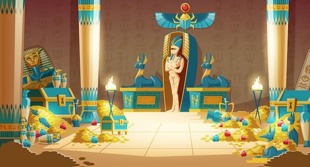 Egipski grobowiec - sarkofag faraona z mumią, skarbem i innymi symbolami kultury.