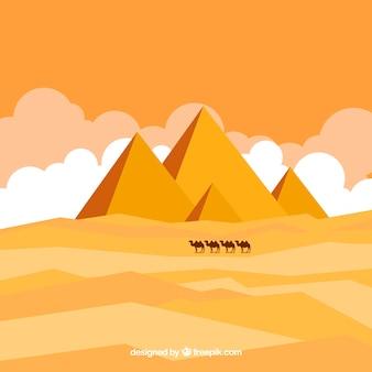Egipski krajobraz pustyni z piramid i karawany