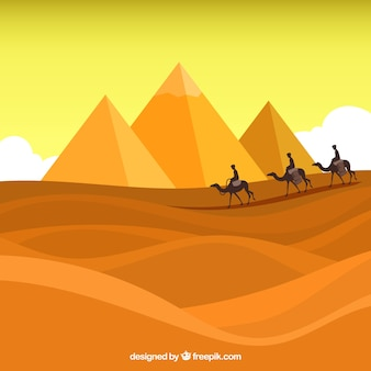 Egipt krajobraz z karawaną i piramidami