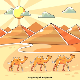 Egipt krajobraz z piramidami i karawaną