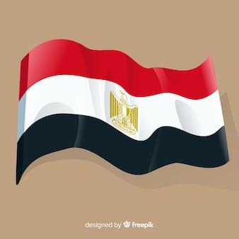 Egipt macha flagą w tle