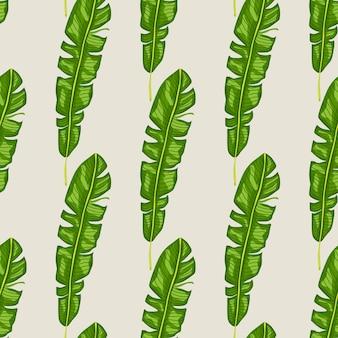 Egzotyczna dżungla wzór z jasnymi zielonymi liśćmi zwrotnikowymi kształtami.