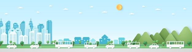 Eko miasto, pejzaż, krajobraz, budynek, wieś i góra z niebieskim niebem i słońcem, ulica, droga z samochodami. papierowy styl artystyczny