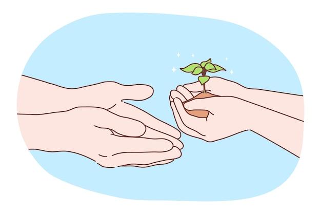 Ekologia, środowisko, miłość do biologii, koncepcja dnia ziemi. ludzki charakter ręce trzymając rosnącą roślinę