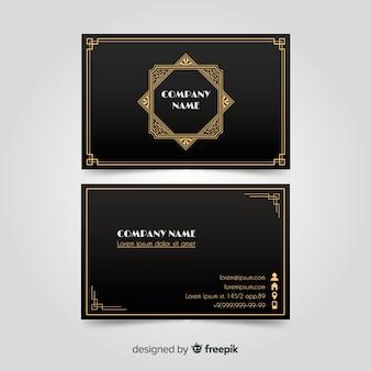 Elegancka czarna wizytówka ze złotymi elementami