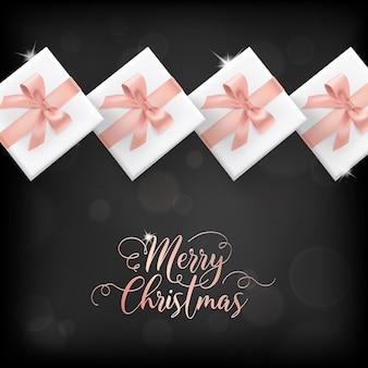 Elegancka kartka merry christmas z różowozłotymi prezentami świątecznymi i prezentami na zaproszenie, pozdrowienia lub ulotkę i broszurę noworoczną 2019