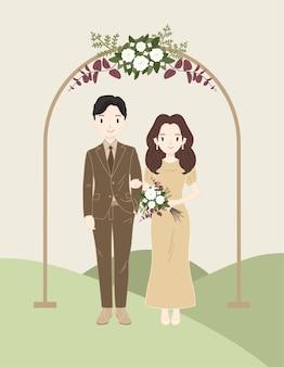 Elegancka para ślubna z brązową sukienką i kwiatem