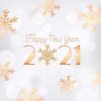 Elegancka pocztówka z życzeniami nowego roku, ulotka z zaproszeniem lub projekt broszury promocyjnej. szczęśliwego nowego roku karta z złote płatki śniegu, brokat na białym niewyraźne tło z 2021 typografią. ilustracja wektorowa