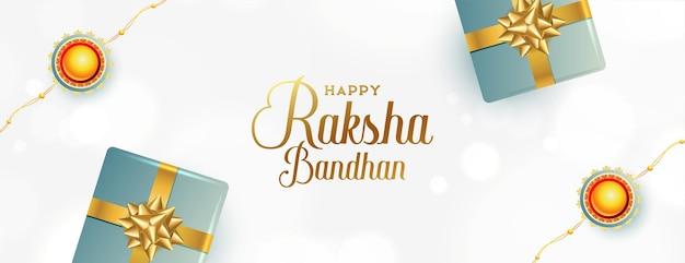 Elegancki baner raksha bandhan z rakhi i pudełkami na prezenty