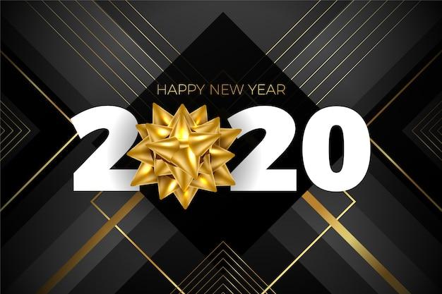 Elegancki ciemny nowy rok 2020 ze złotą kokardą