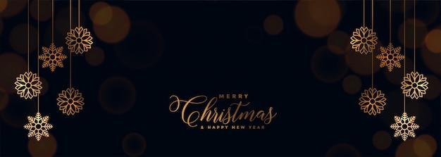 Elegancki czarny świąteczny baner ze złotymi płatkami śniegu