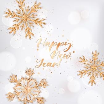 Elegancki kartkę z życzeniami szczęśliwego nowego roku ze złotymi płatkami śniegu i brokatem na białym niewyraźne tło i napis. życzenia bożonarodzeniowe lub noworoczne, pocztówka świąteczna, ulotka z zaproszeniem lub projekt broszury
