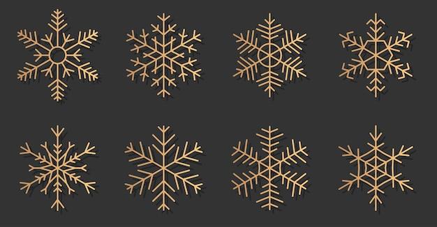 Eleganckie sylwetki zestaw ikon złota płatki śniegu. śnieg na banner wesołych świąt i szczęśliwego nowego roku