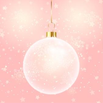 Eleganckie tło bożonarodzeniowe z wiszącą bombką na różowym gwiaździstym wzorze