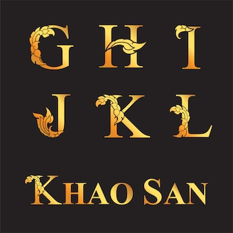 Eleganckie złote litery g, h, i, j, k, l z elementami tajskiej sztuki.