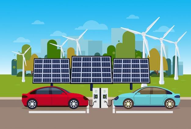 Elektrownia z pojazdami ładującymi nad trurbinami wiatrowymi i bateriami paneli słonecznych koncepcja ekologicznego samochodu elektrycznego