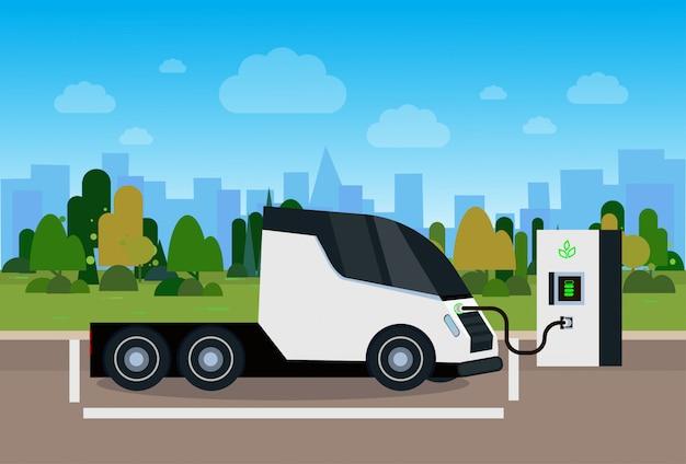 Elektryczna ciężarówka ładująca pojazd na stacji eco przyjazna koncepcja wózka