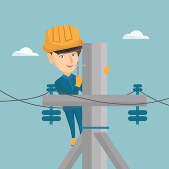 Elektryk pracuje na słupie energii elektrycznej.
