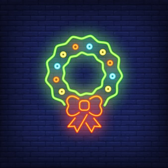 Element neonowy znak Boże Narodzenie wieniec. Bożenarodzeniowy pojęcie dla nocy jaskrawej reklamy