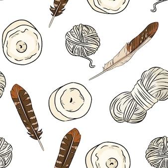 Elementy boho, pióra, świece, nici bawełniane wzór.