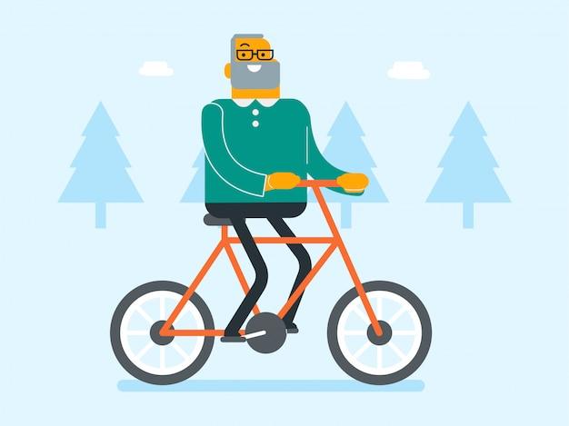 Emerytowany biały człowiek kaukaski jazda rowerem w parku