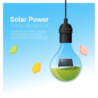Energetyczny pojęcia tło z panelem słonecznym w żarówce