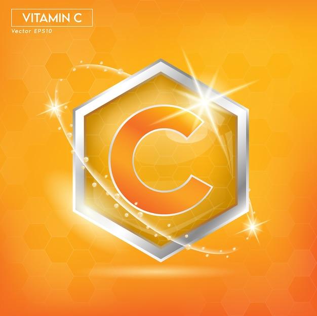 Etykieta koncepcyjna witaminy c pomarańczowymi literami w kolorze srebrnym. do projektowania produktów.