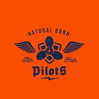 Etykieta retro urodzonych pilotów samolotów lub szablon logo. airscrew na tarczy ze skrzydłami i typografią. na pomarańczowym tle