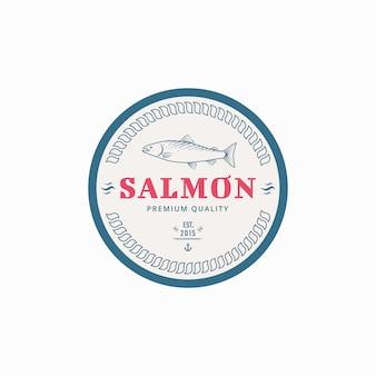 Etykieta wędkarska z rybami łososiowymi.