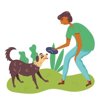 Facet bawiący się z psem w latającym spodku